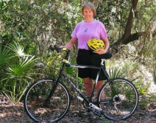 Kathy with her bike Destiny.