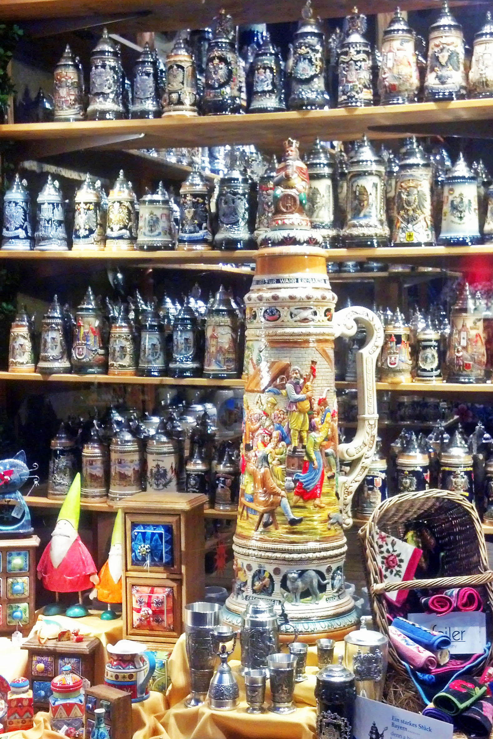 A store window full of steins.