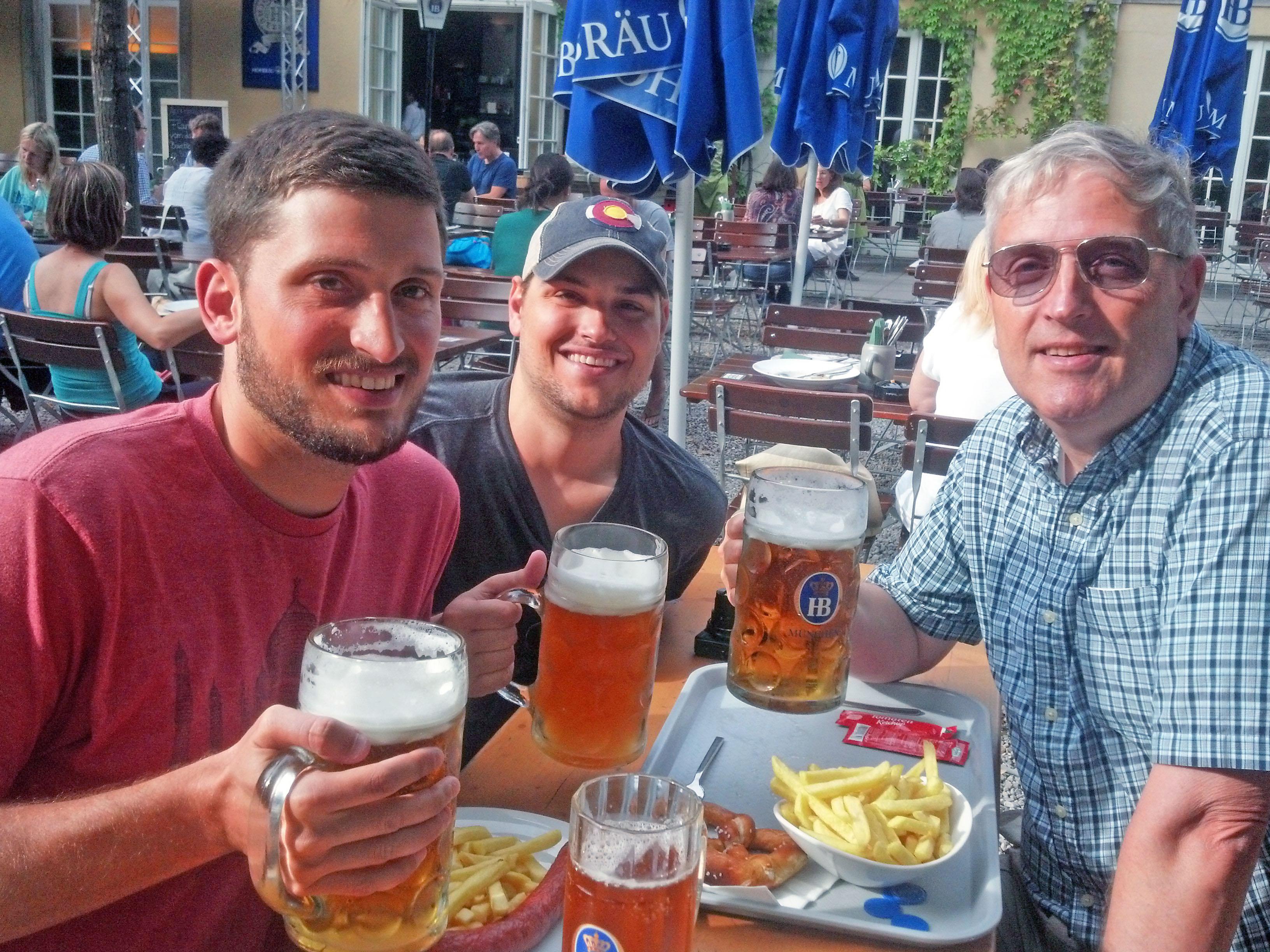 The guys drinking dinner in a Munich Beer Garden.