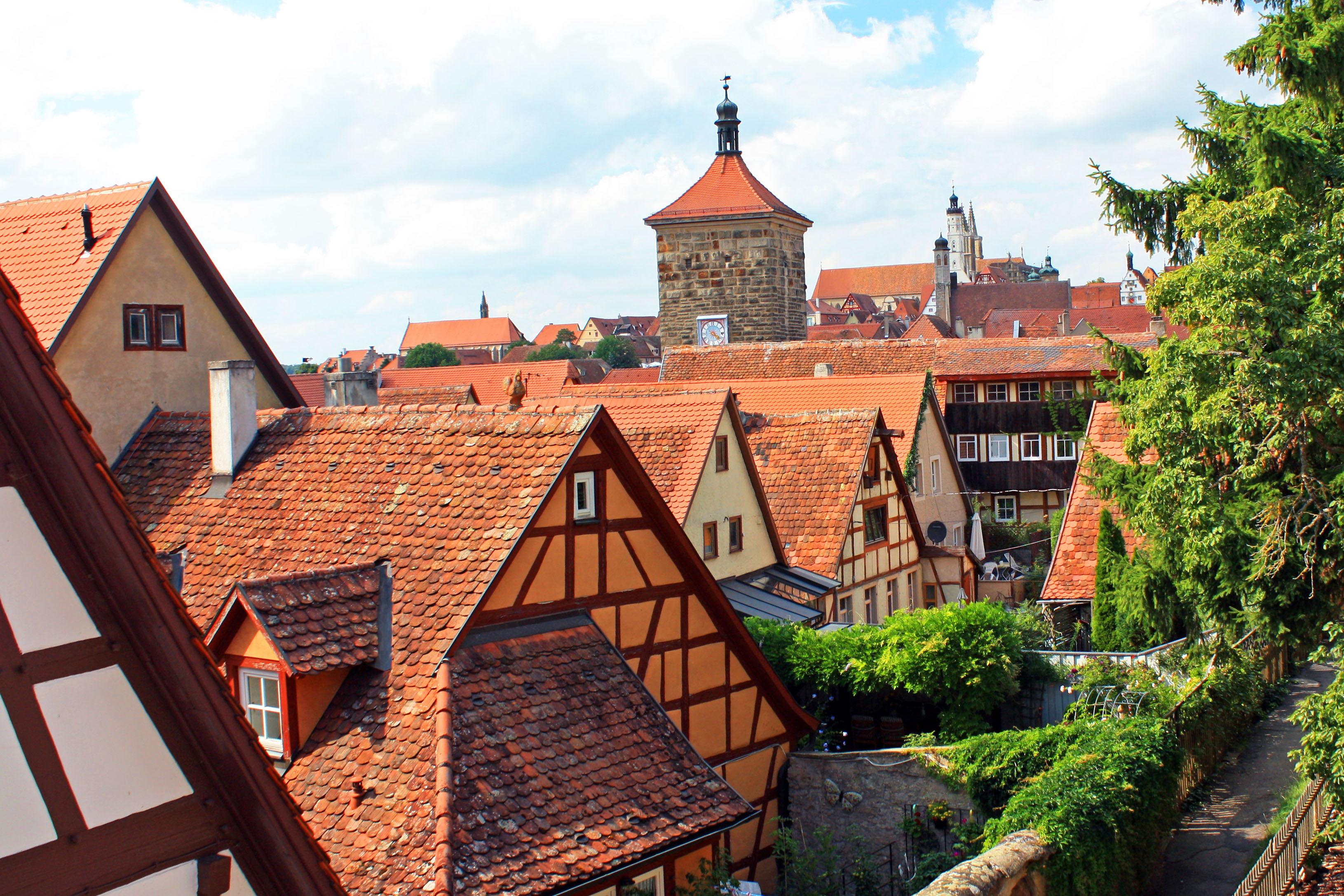 A town wall view of Rothenburg with a tower in the distance.