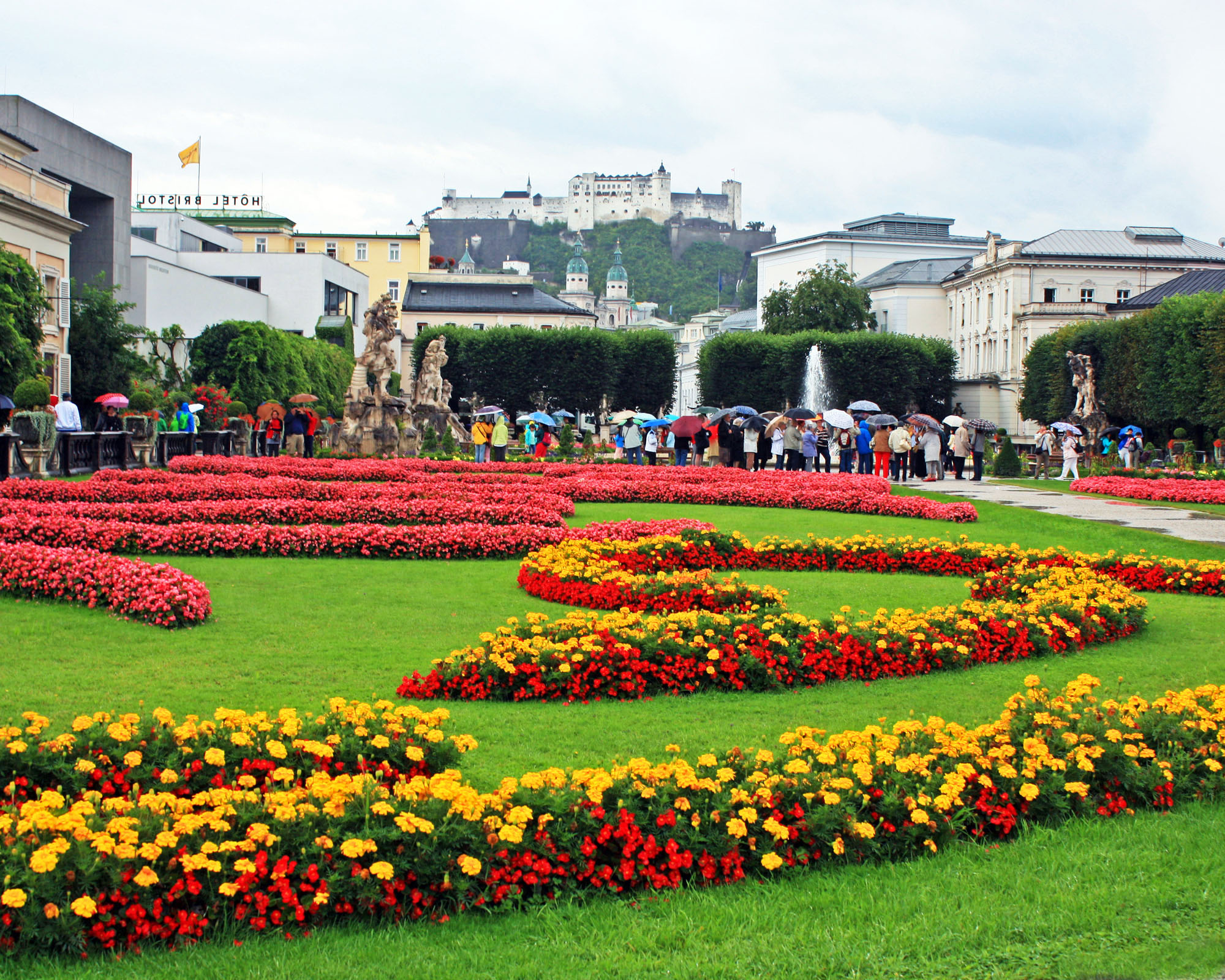 Beautiful Mirabell Gardens with Hohensalzburg Fortress in the background.