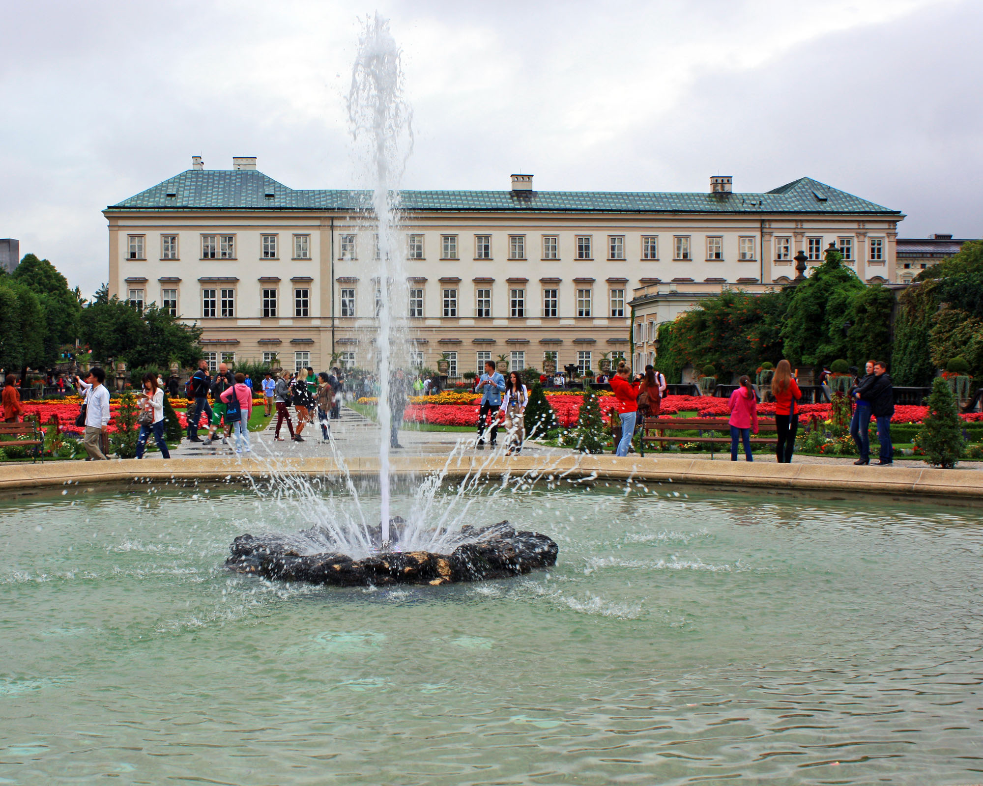 Mirabell Gardens Fountain with Mirabell Palace in the background.