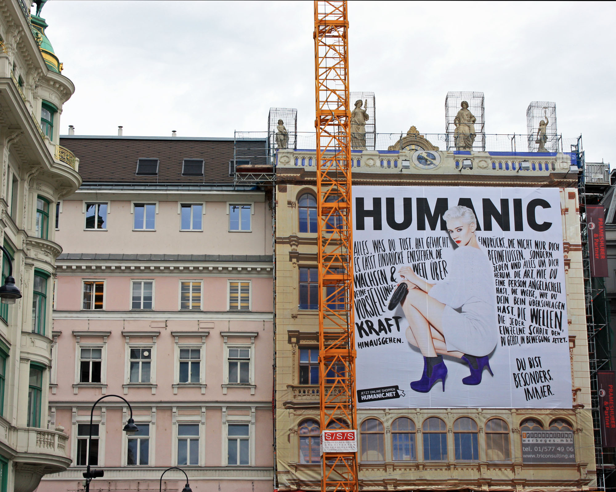 Interesting mural on a building being renovated in Vienna.