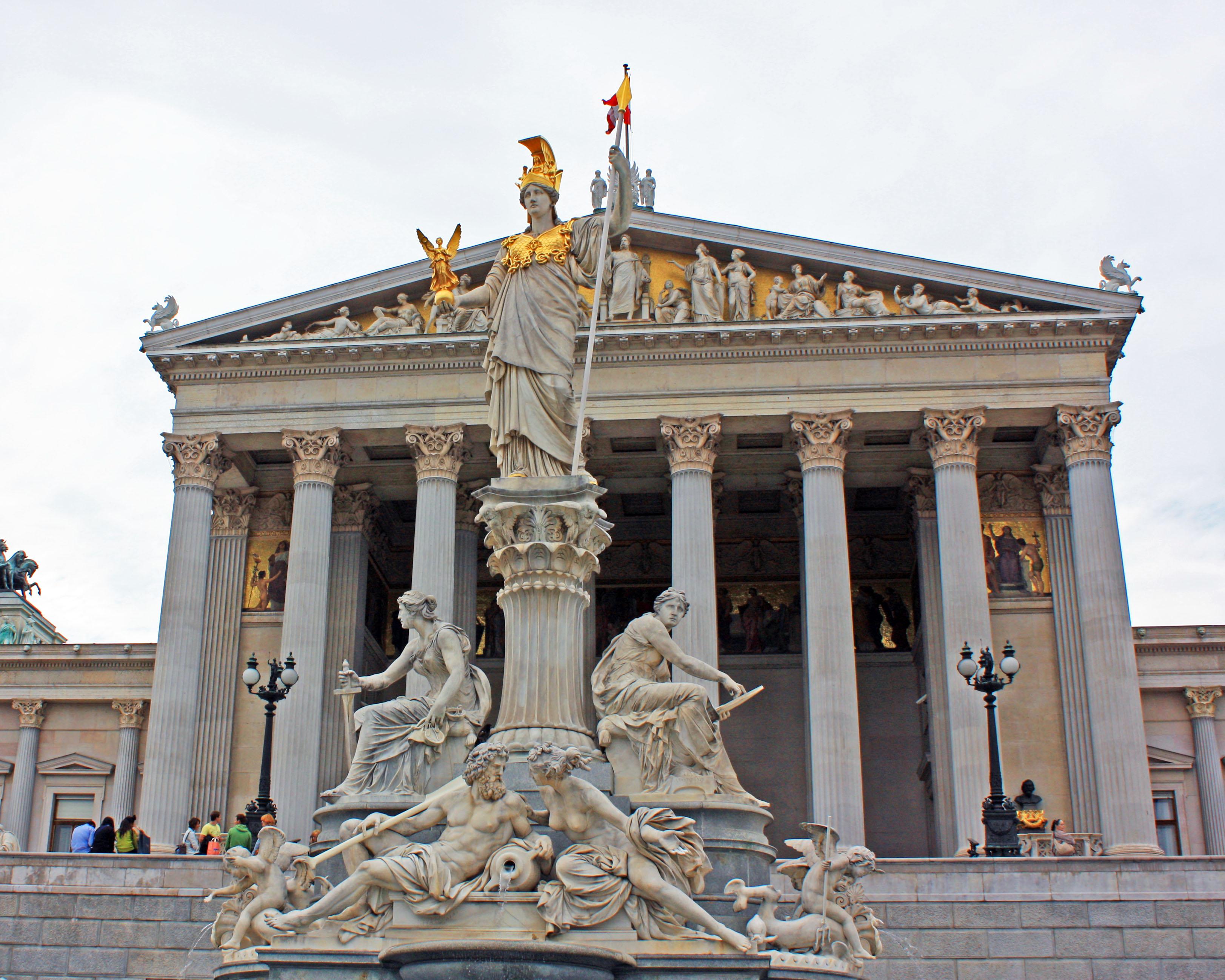 Austrian Parliament with a statue of Athena, the goddess of wisdom.
